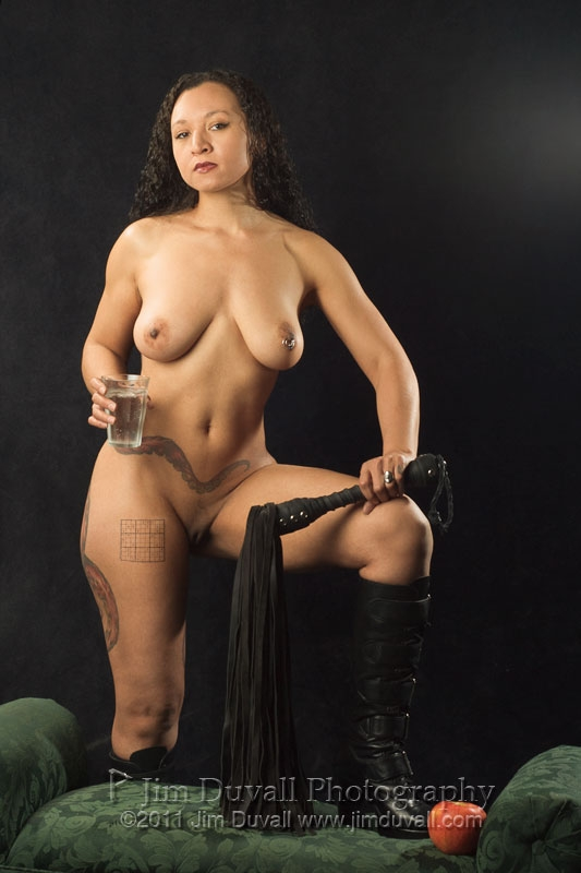 nude woman standing with a whip and a sudoku puzzle on her hip