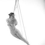 nude woman tied and suspended in rope model: Rose Riley